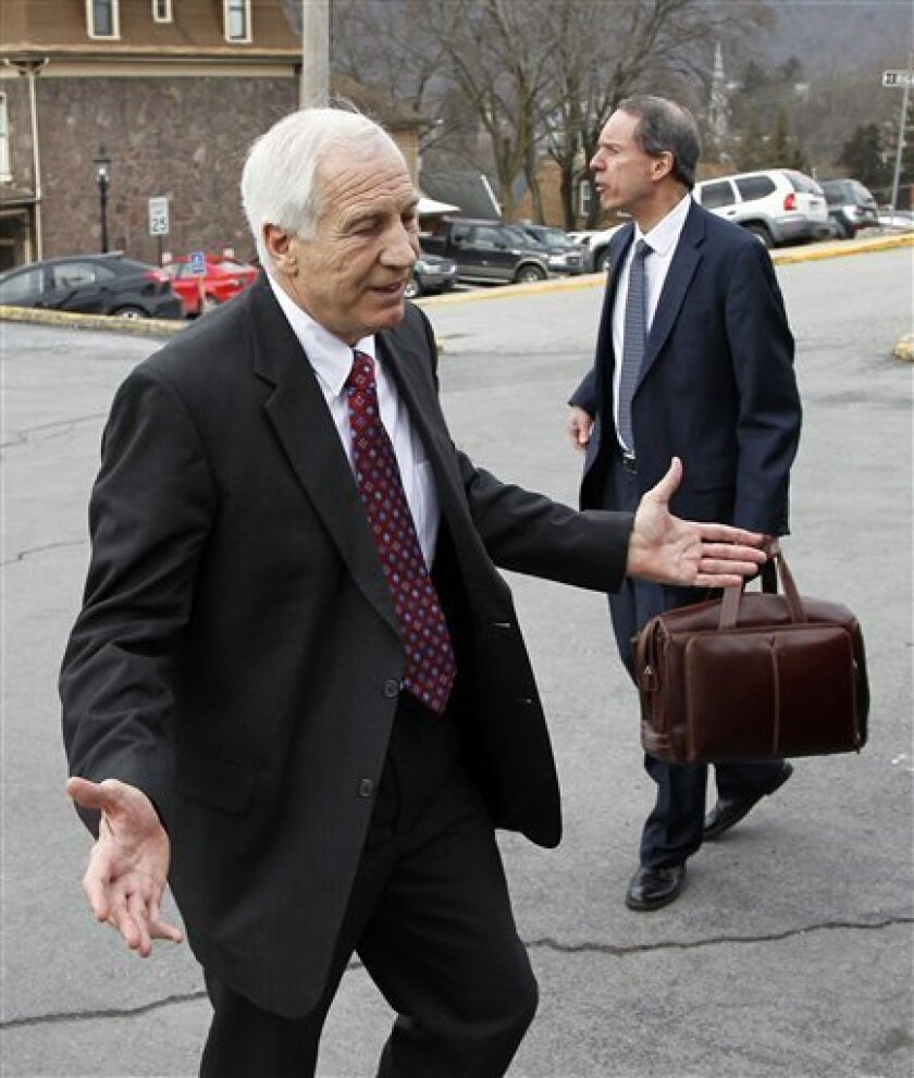 Jerry Sandusky, left, a former Penn State assistant football coach charged with sexually abusing boys, departs with his attorney Joe Amendola, from the Centre County Courthouse after a bail conditions hearing Friday, Feb. 10, 2012 in Bellefonte, Pa. (AP Photo/Alex Brandon)