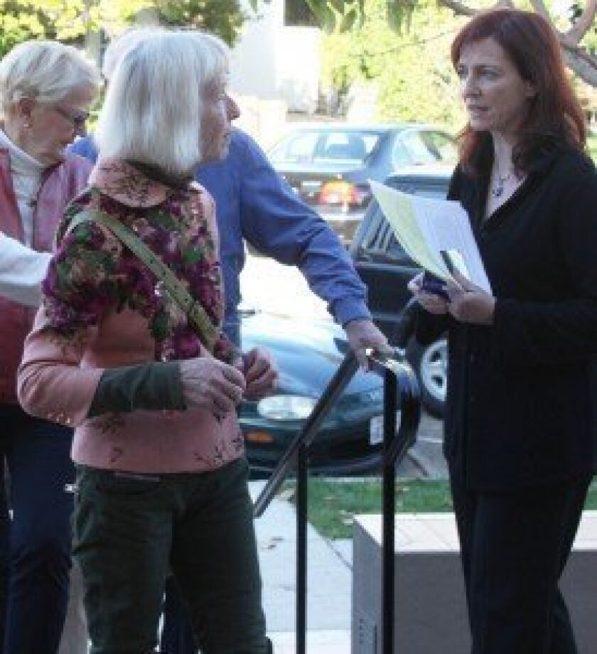 Task Force Chair Leslie Davis (right) speaks with the La Jolla Historical Society's Carol Olten prior to a community meeting with USPS reps earlier this year. File photo