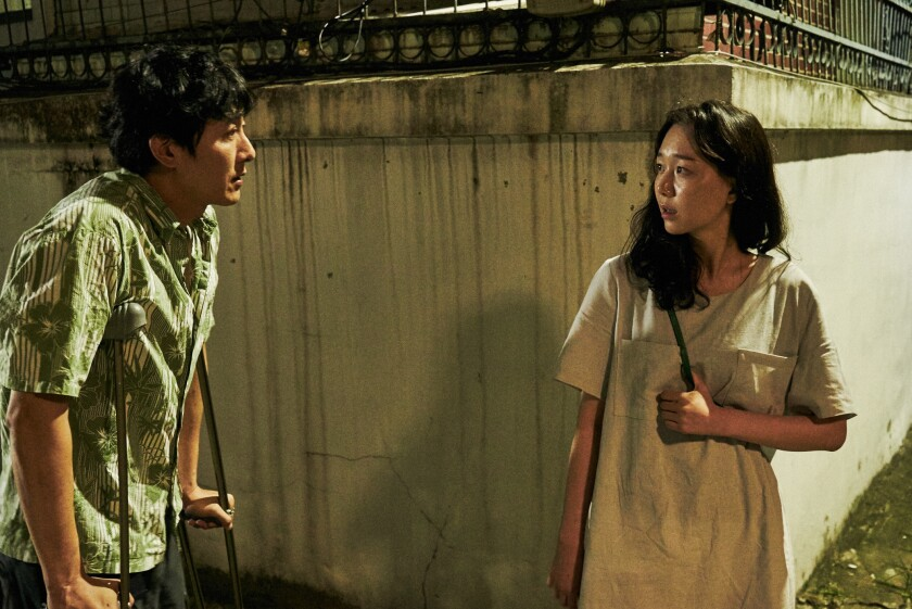 "Kim Joo-hyuk, left, and Lee Yoo-young in Hong Sang-soo's ""Yourself and Yours."""