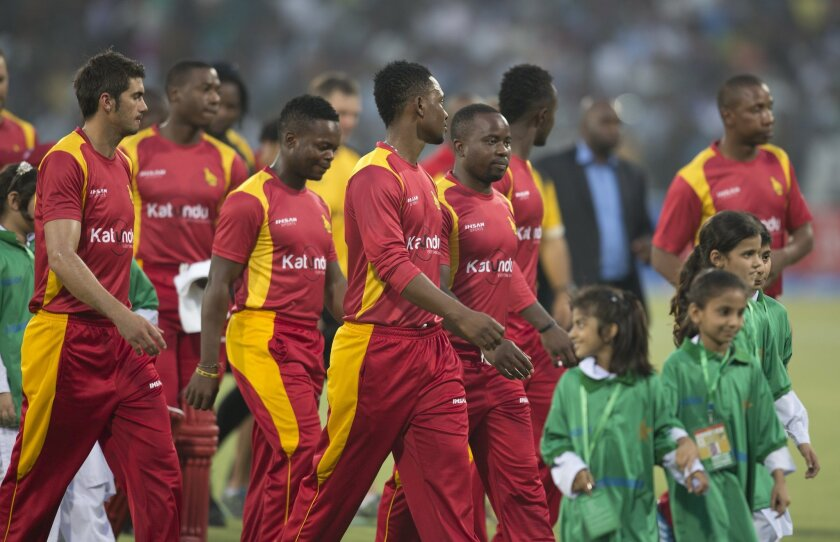 Zimbabwean cricket players enter the ground to play against Pakistan at the Gaddafi stadium in Lahore, Pakistan, Friday, May 22, 2015. Zimbabwe is the first test playing nation to visit Pakistan in more than six years since gunmen attacked a bus of the Sri Lanka team in Lahore in 2009. (AP Photo/B.K. Bangash)