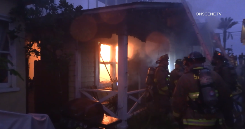 A fire damaged three homes in Mission Beach early Sunday and one firefighter suffered a minor burn injury, officials said.