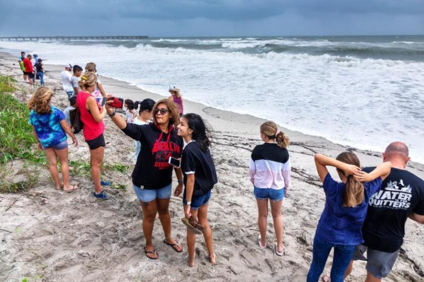 Beachgoers photograph the ocean alongside the Juno Beach Pier in Juno Beach, Florida, USA, 02 September 2019. EFE/EPA/Cristobal Herrera