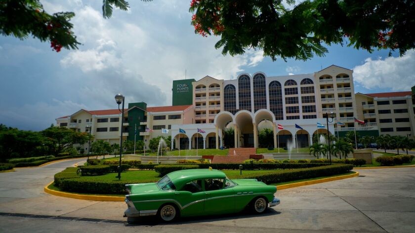 FILE - In this June 28, 2016 file photo, a vintage car passes in front of the Four Points by Sherato