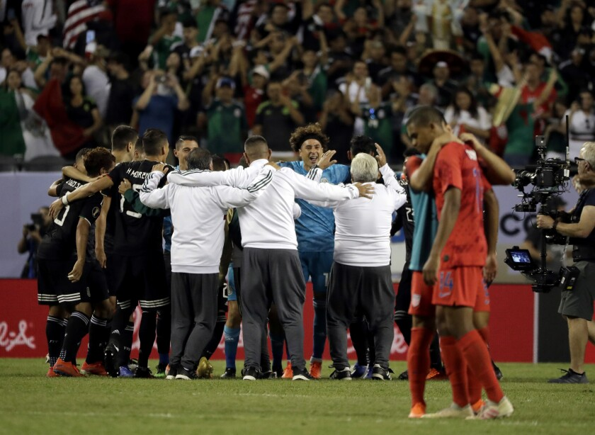 Players from the Mexican national team celebrate after a 1-0 win over the U.S. in the CONCACAF Gold Cup final July 7, 2019.