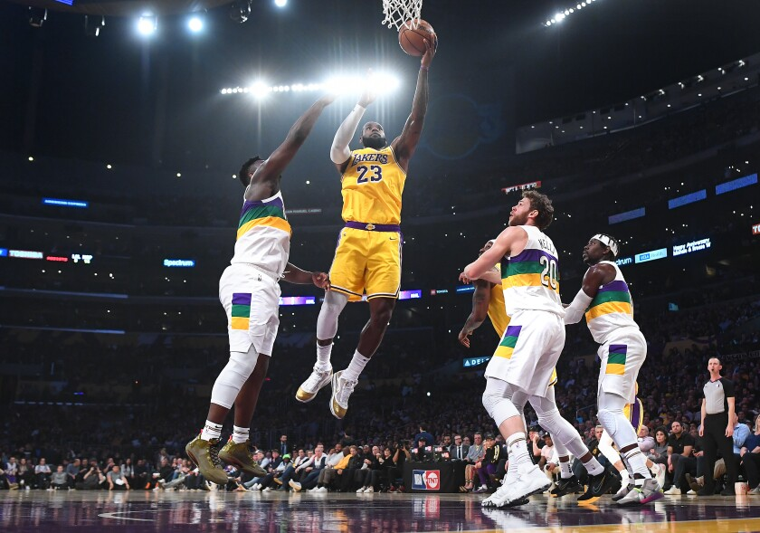 LeBron James scores against Zion Williamson on Tuesday at Staples Center