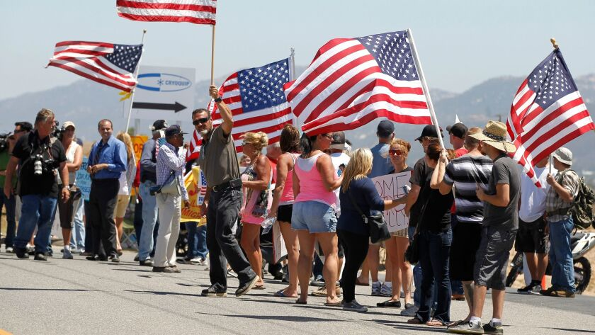Opponents of those who illegally enter the United States gather in front of the Border Patrol facility in Murrieta in 2014.