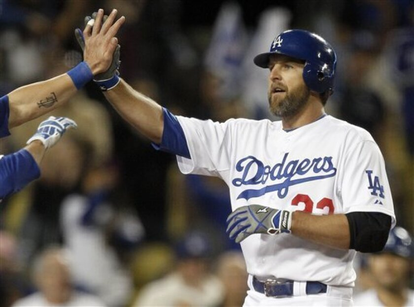 Los Angeles Dodgers' Casey Blake celebrates his three-run home run against the Colorado Rockies during the seventh inning of a baseball game in Los Angeles, Tuesday, May 31, 2011. (AP Photo/Chris Carlson)