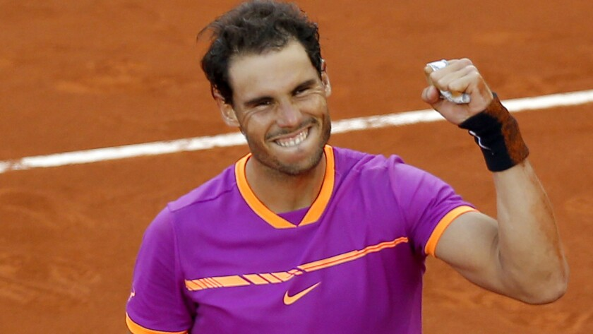 Rafael Nadal celebrates after defeating Dominic Thiem in the Madrid Open championship match on Sunday.