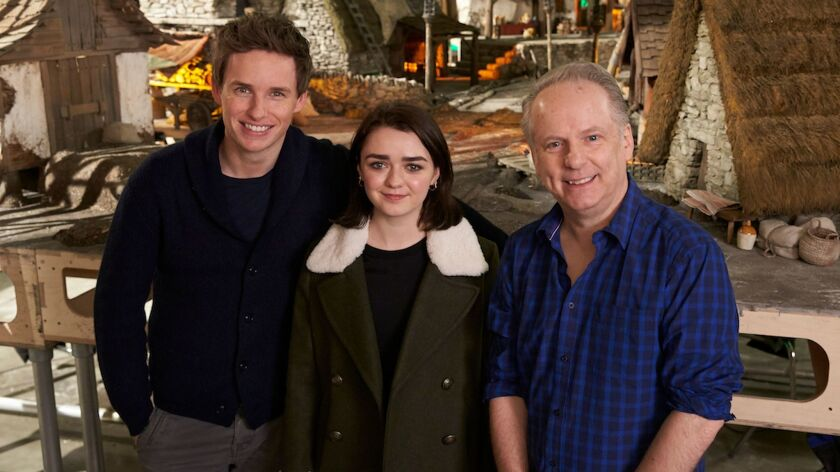 """(L-R) - Eddie Redmayne, Maisie Williams, and Director Nick Park on the set of """"EARLY MAN."""" Credit:"""