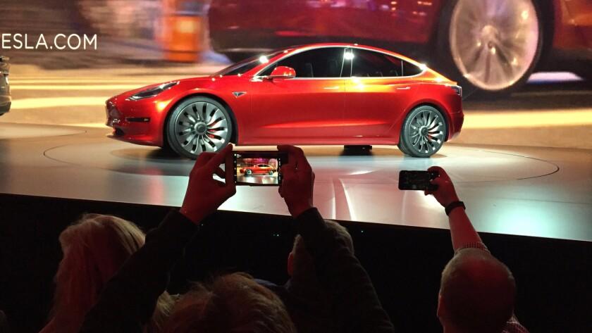 Tesla Motors unveils its Model 3 sedan at the company's design studio in Hawthorne on March 31.