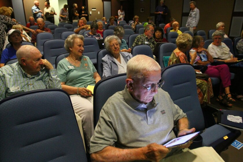 Residents pay close attention during a computer class Friday at the La Costa Glen retirement home in Carlsbad.