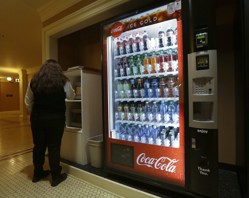 A Coca-Cola vending machine sits in the basement of the state Capitol as members of the Legislature