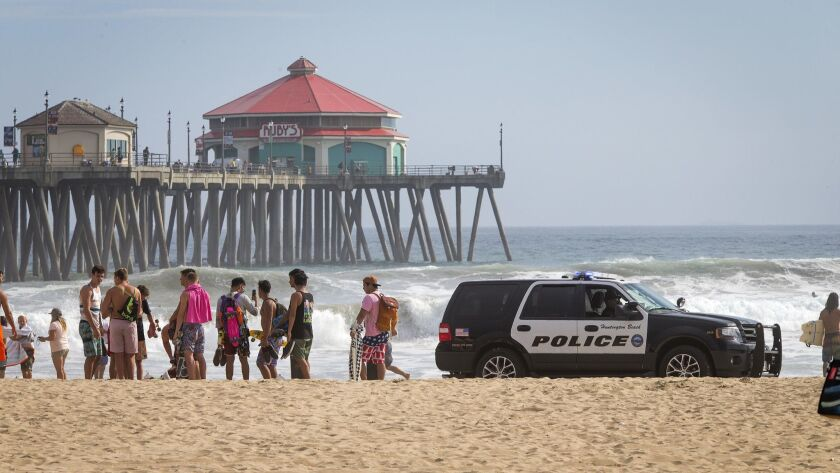HUNTINGTON BEACH, CALIF. -- TUESDAY, AUG. 1, 2017: Huntington Beach police tell beach-goers to evacu