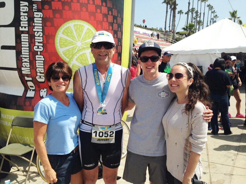 Carmel Valley's Jeff Tuetken at the 2014 Ironman 70.3 California in Oceanside with his wife, Reba, and children Adam and Alyssa.