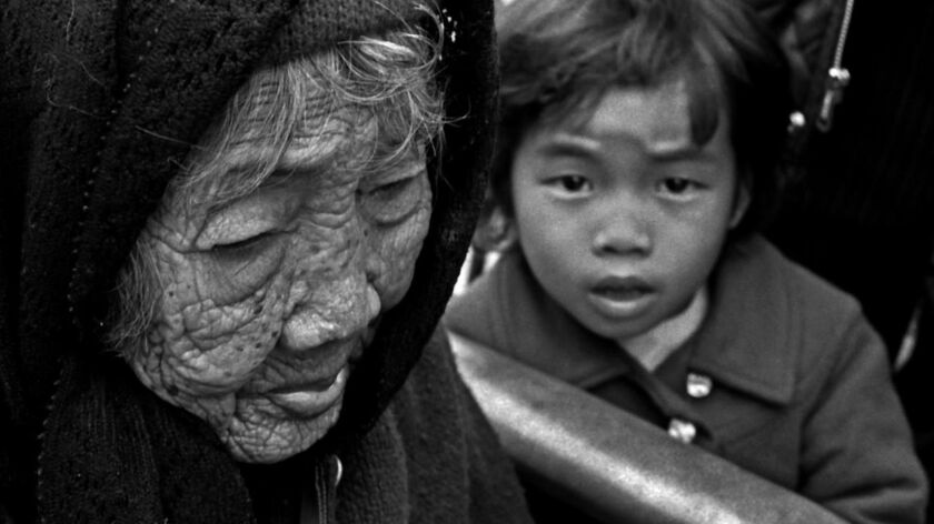 An elderly Vietnamese woman and young child at Camp Pendleton refugee camp.
