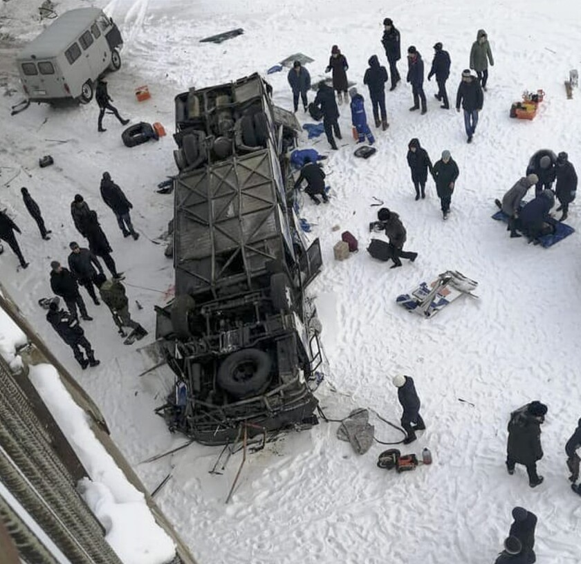 This photo provided by dtp38rus shows the bus after plunging from a bridge over the Kuenga River, about 4900 kilometers (3100 miles) east of Moscow, 60 kilometers (38 miles) from Sretensk, Russia, Sunday, Dec. 1, 2019. Russian emergency officials say more then 10 people were killed when their bus plunged off a bridge onto a frozen river in eastern Siberia. (dtp38rus via AP)