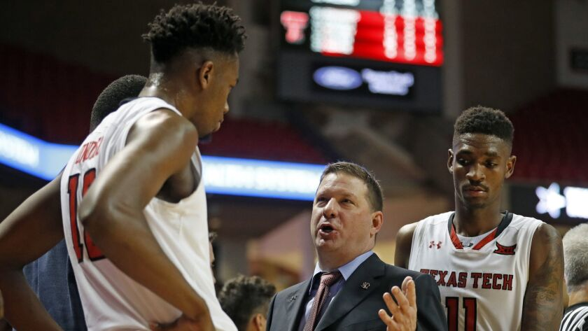 Texas Tech coach Chris Beard talks to Malik Ondigo (10) during the second half of an NCAA college ba