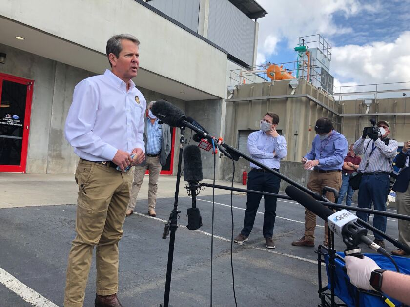 Georgia Gov. Brian Kemp speaks to the media May 15 after touring a chicken processing plant in Gainesville, Ga.