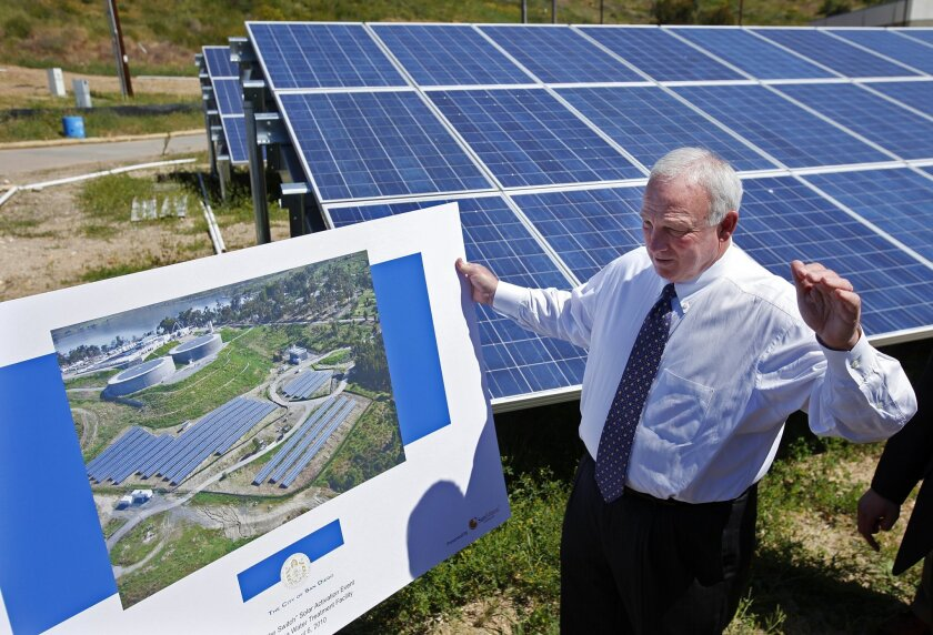 Happier days: San Diego Mayor Jerry Sanders visits a solar power plant at the city's Otay Mesa Water Treatment Facility as the project is turned on in April 2010.