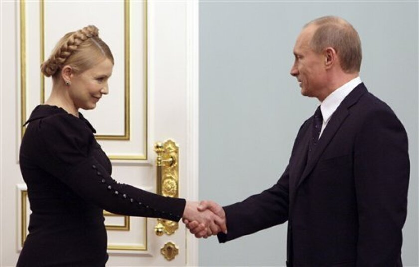 Russian Prime Minister Vladimir Putin, right, greets Ukrainian Prime Minister Yulia Tymoshenko who is in Moscow for talks aimed at restoring Russian natural gas supplies to Europe, Saturday, Jan. 17, 2009. Yulia Tymoshenko  met with Vladimir Putin briefly before they both headed to the Kremlin for