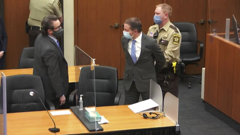 In this image from video, former Minneapolis police Officer Derek Chauvin, center, is taken into custody