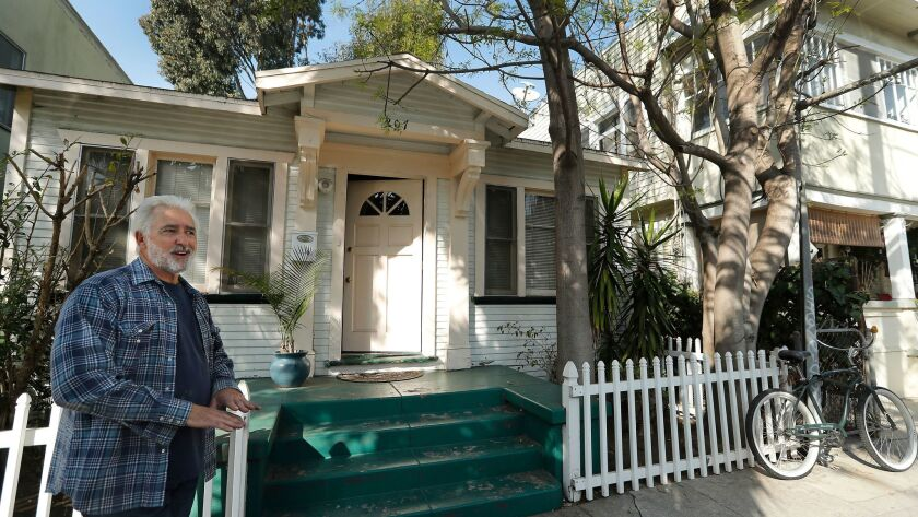 VENICE, CA-JANUARY 18, 2018: John Okulick stands next to a home, left, at 207 Horizon Ave. in Veni
