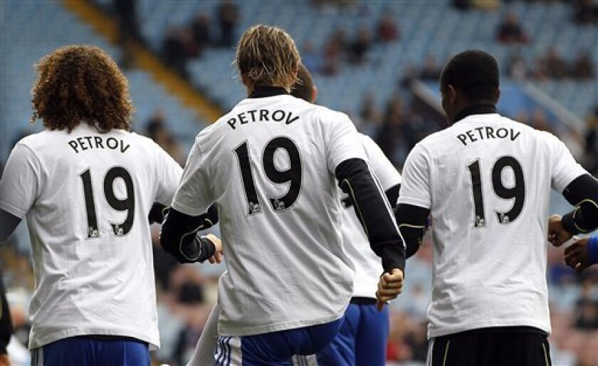Chelsea's players wear t-shirts of support for Aston Villa's Stiliyan Petrov, who has been diagnosed with Leukemia, ahead of the English Premier League soccer match between Chelsea and Aston Villa at Villa Park Stadium in Birmingham, Saturday, March 31, 2012. (AP Photo/Kirsty Wigglesworth)