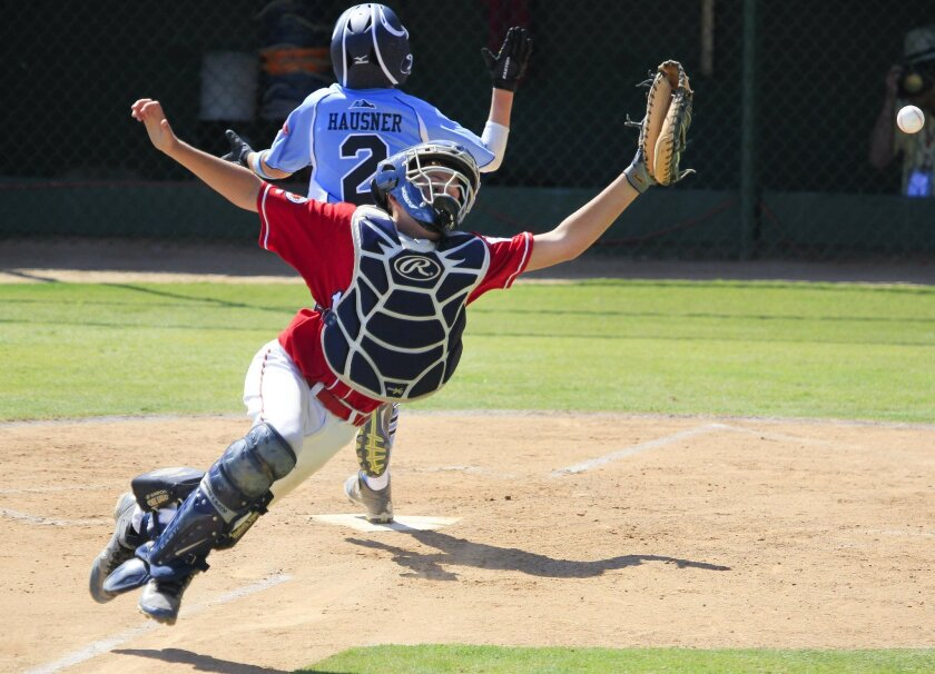 Austin Machado of the Encinitas All-Stars leaps for a ball during play against the Mountain Ridge All-Stars from Las Vegas during the Little League West Regional semifinals in San Bernardino. Encinitas fell to Mountain Ridge 5-1, ending their run at the Little League World Series.