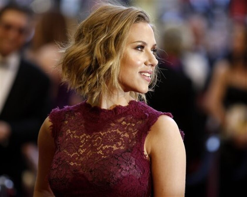 """Actress Scarlett Johansson """"duets"""" with Dean Martin on """"I'll Be Home For Christmas."""" She also stars in """"We Bought a Zoo,"""" the new film by San Diego-bred director Cameron Crowe. (AP Photo/Chris Carlson)"""