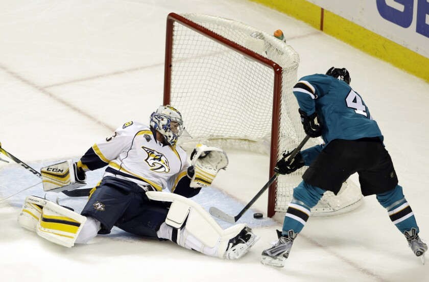 Sharks tk Joel Ward scores on Predators goalie Pekka Rinne during the third period of Game 1 of the teams' second-round playoff series on April 29.