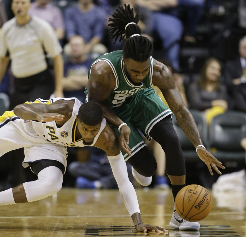 Indiana Pacers forward Paul George, left, and Boston Celtics' Jae Crowder go for a loose ball during the second half of an NBA basketball game Wednesday, Nov. 4, 2015, in Indianapolis. The Pacers won the game 100-98. (AP Photo/Darron Cummings)