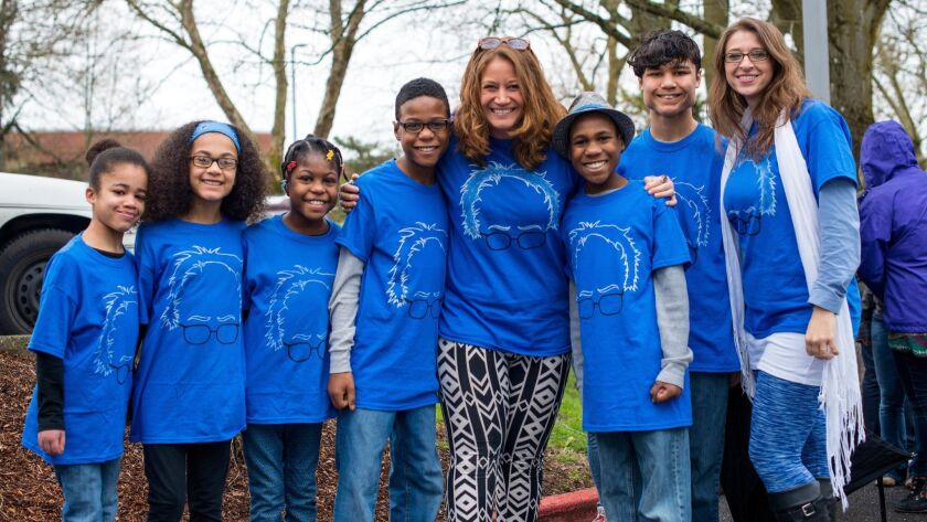 The Hart family of Woodland, Wash., appears at a Bernie Sanders rally. Authorities have said the crash off a coastal cliff that is believed to have killed all eight of them was intentional.