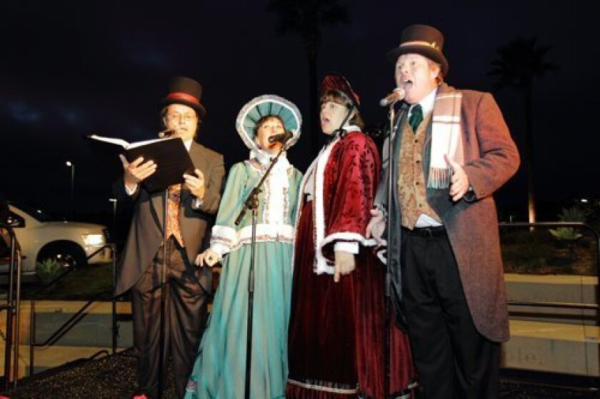Carolers sing at the Del Mar Highlands center holiday event