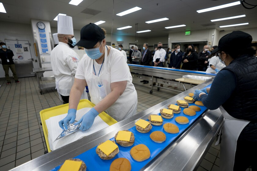 California officials were given a tour of the main convention center's kitchen.