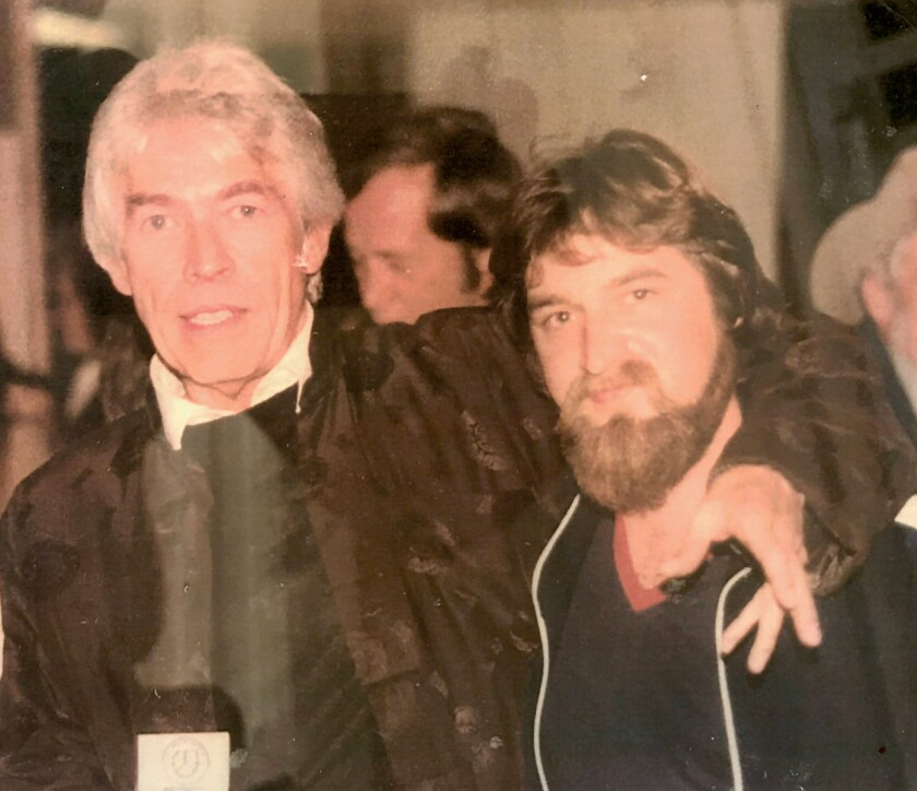 Actor James Coburn socializes with Black Canyon Blues Band performer Robert Anderson.