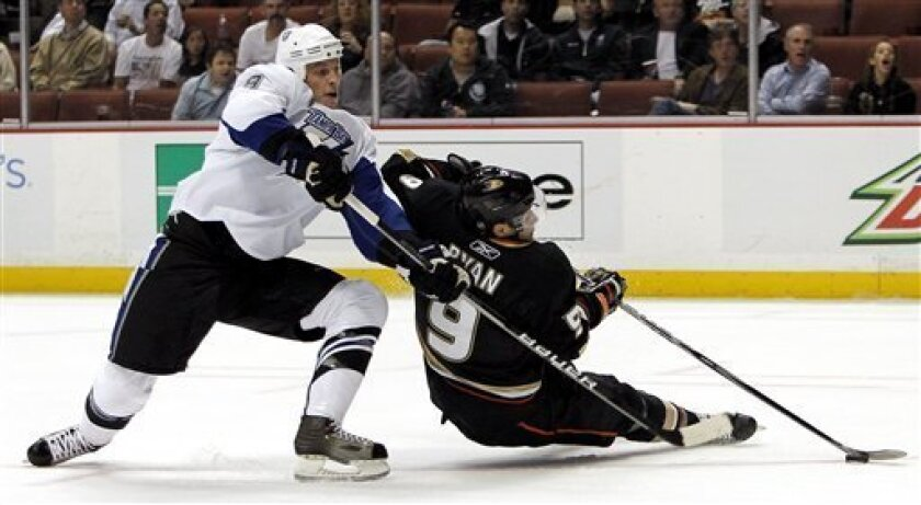 Tampa Bay Lightning defenseman Randy Jones, left, works against Anaheim Ducks right wing Bobby Ryan (9) during the second period of an NHL hockey game in Anaheim, Calif., Wednesday, Nov. 3, 2010. (AP Photo/Alex Gallardo)