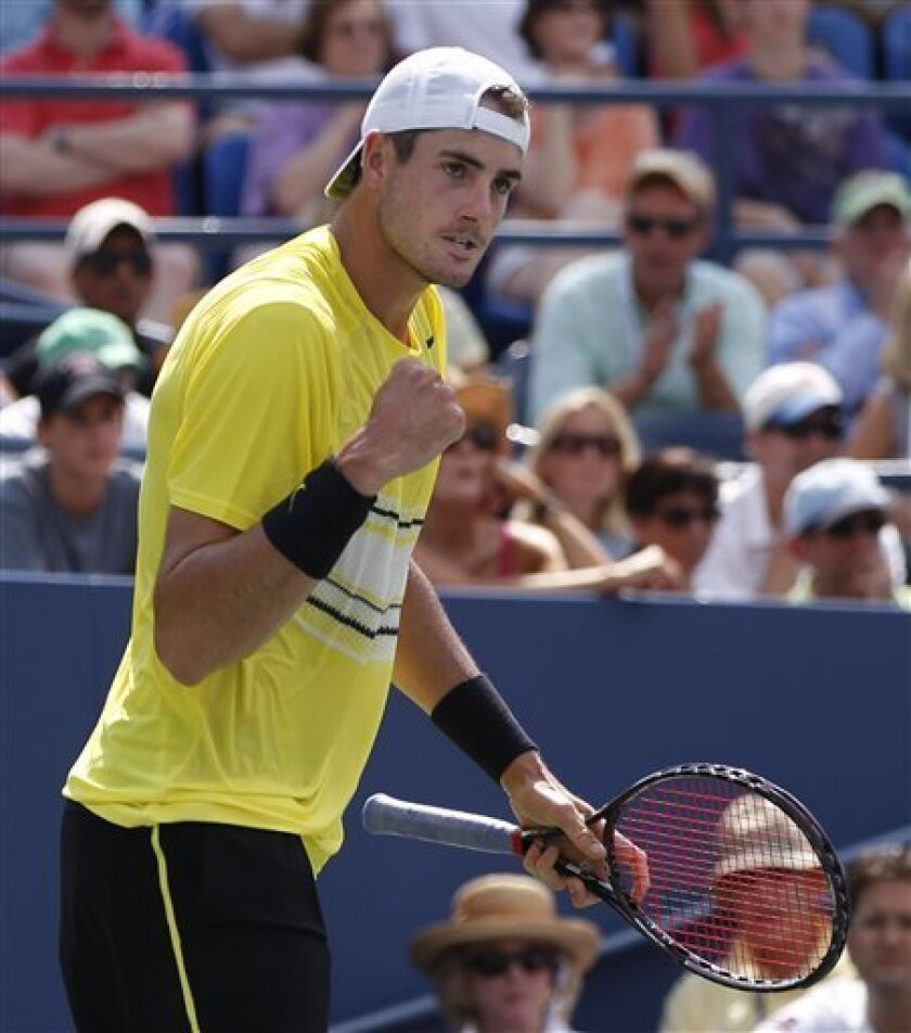 John Isner of the United States reacts after winning the first set in his match against Robby Ginepri during the U.S. Open tennis tournament in New York, Friday, Sept. 2, 2011. (AP Photo/Paul J. Bereswill)