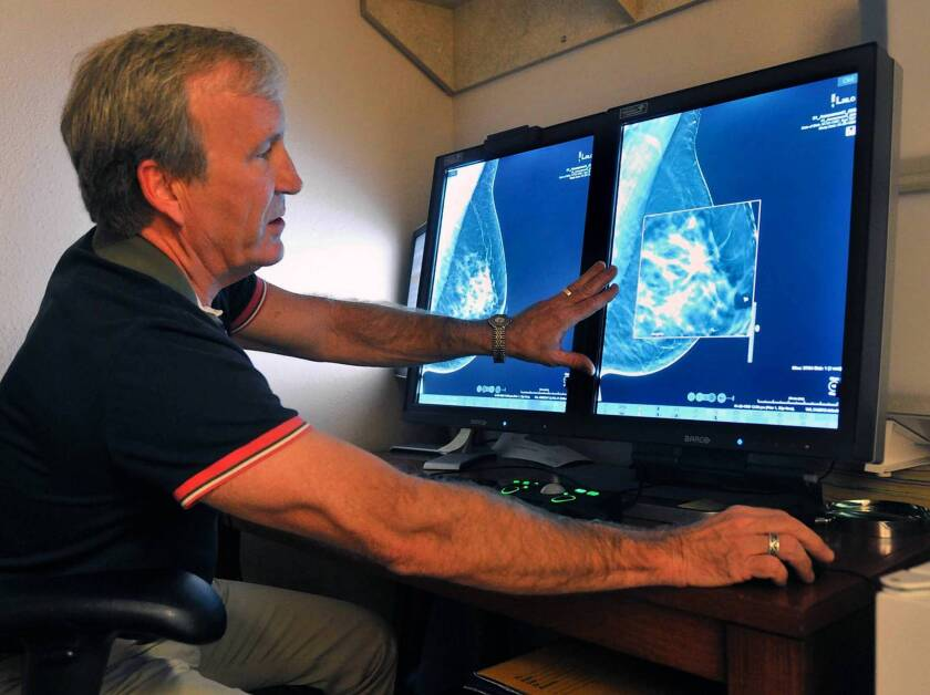Radiologist Paul Bice compares a 2-D mammogram with a 3-D version, which offers more detail.