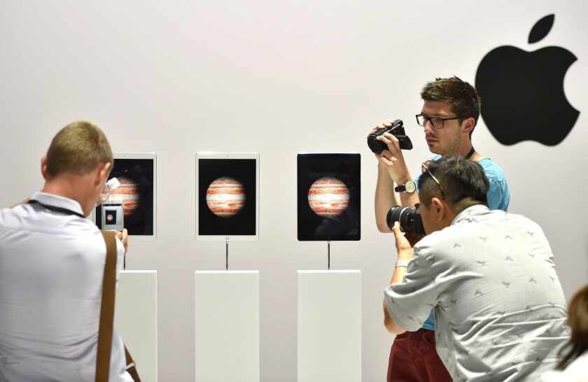 People take photos and videos of the iPad Pro during an Apple event in San Francisco on Wednesday.