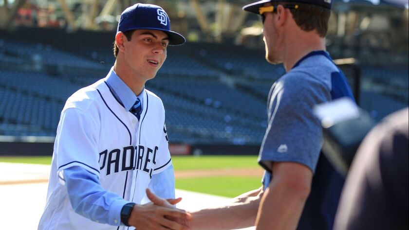 SAN DIEGO, June 24, 2017 | Padres first-round selection left handed pitcher MacKenzie Gore, left, s