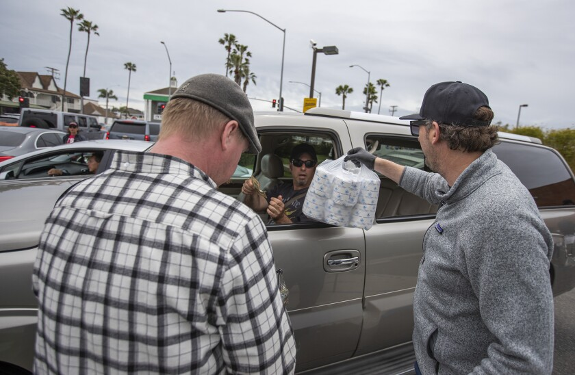 Cheers for toilet paper as Newport Beach pub owner rolls out a day of distribution