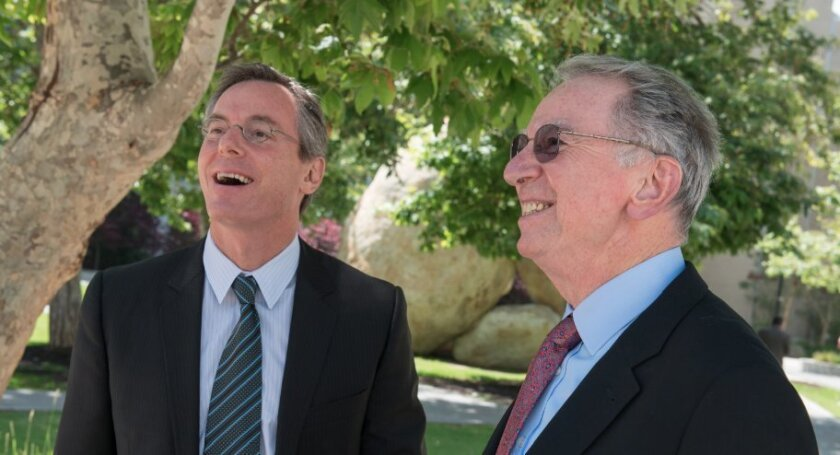 Qualcomm CEO Paul Jacobs (left), with his father, company founder Irwin Jacobs.