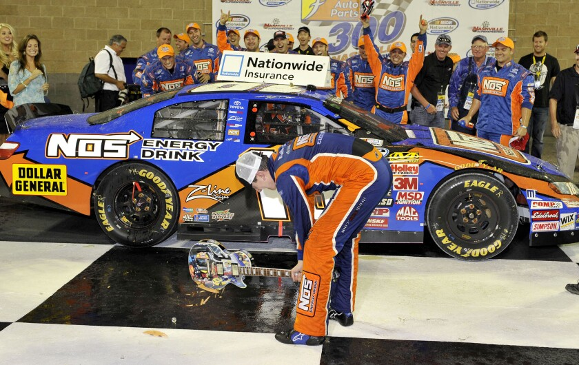 FILE - Kyle Busch smashes the guitar trophy after winning the NASCAR Federated Auto Parts 300 Nationwide Series auto race at Nashville Speedway in Gladeville, Tenn., in this Saturday, June 6, 2009, file photo. Nashville Speedway, the track that had been shuttered for a decade will host its first ever Cup race on Sunday, June 20, 2021. (AP Photo/Donn Jones, File)