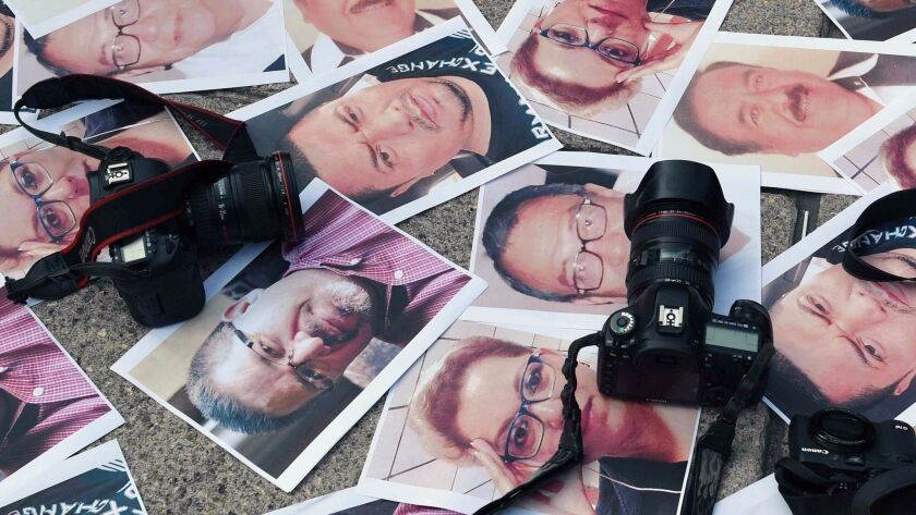 Cameras and pictures of journalists recently slain in different Mexican states are placed at the An