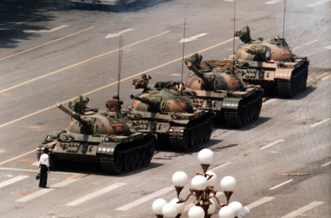 In this June 5, 1989, a Chinese protester blocks a line of tanks in front in Beijing.