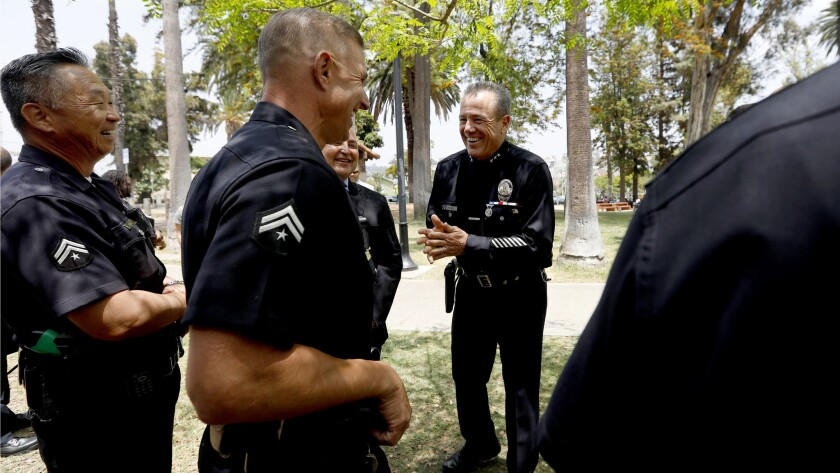 LOS ANGELES, CA JUNE 5, 2018: LAPD veteran Michel Moore, center, jokes with the other LAPD office