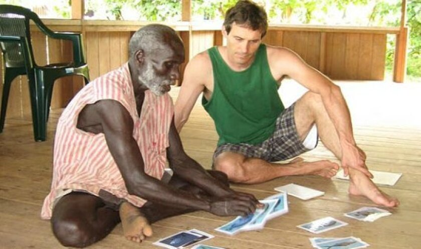 Matt Lauer (right) working on fish categorization in the Solomon Islands.