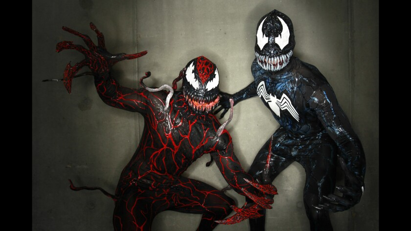 Greg Bowlin, left, and Justin Smith dressed as Carnage and Venom from Batman at Comic-Con.