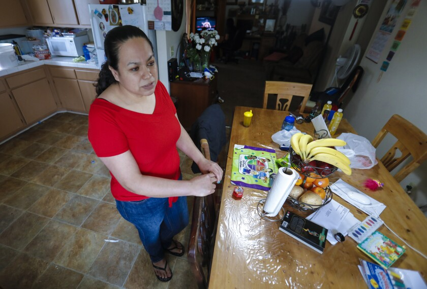 Maria Penuelas, a single parent and the sole provider for her family of five. She's had to be open to taking on various jobs at the local grocery store where she works so that she can maintain her 40-hour work week.