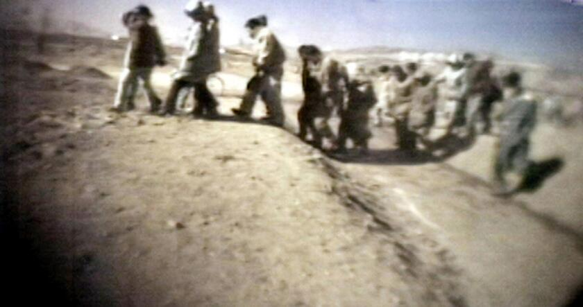 This image from an unverified video apparently showing North Korean prisoners heading to a public trial aired on Japanese television in March 2005. The network claimed to have obtained footage of two public executions in North Korea from people inside the country.